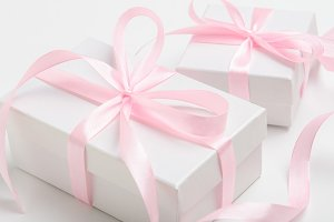 White gift box with pink ribbon.