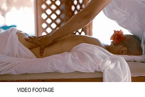 Woman getting body massage at beauty