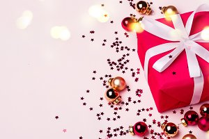 Christmas Red Gift Box on Pastel Bac