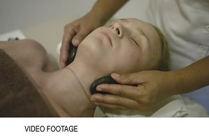 Woman under spa neck massage