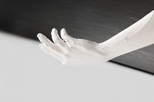 cropped image of female hand in whit