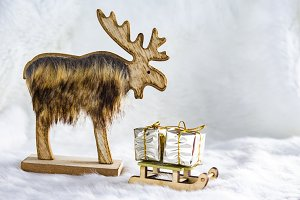 Reindeer with a sled full of gifts