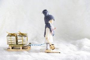 Skier dragging a sleigh full of gift