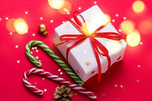 Christmas gift box and candy cane wi
