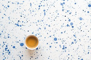 Cup of coffee on abstract background
