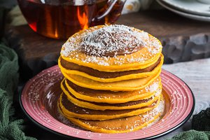 Pumpkin pancakes stack served with