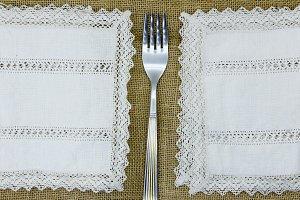 fork between lace napkins