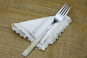 Fork on lace napkin