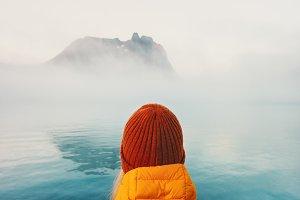 Traveler alone looking at foggy sea