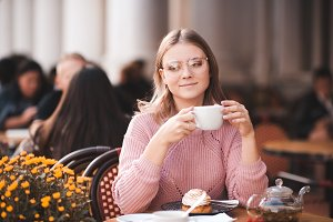 Girl in cafe with cup