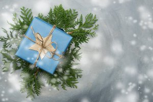 Christmas gift box in blue wrapping