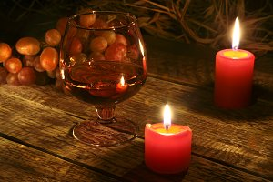 christmas candles, grapes and glass