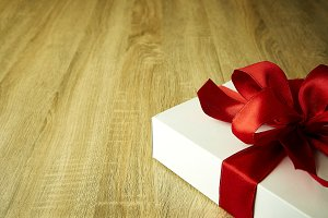 Wrapped present box on wooden board