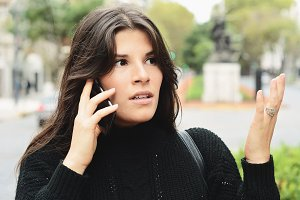 Young woman talking on her mobile ph