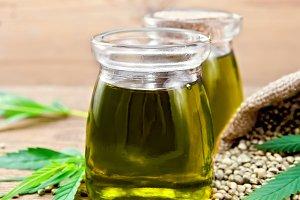 Oil hemp in two jars with sheet