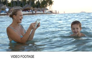 Mother with pad making photo video