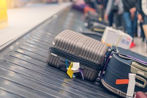 Suitcase or luggage with conveyor