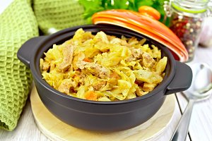 Cabbage stew with meat in brazer