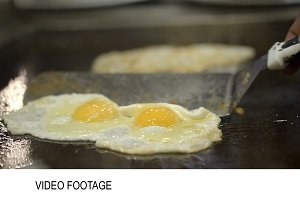 Two portions of fried eggs cooked