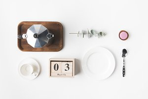 flat lay with coffee maker, calendar