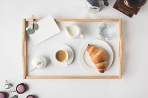 flat lay with cup coffee and croissa