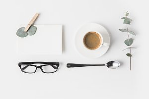 top view of eyeglasses, cup of coffe