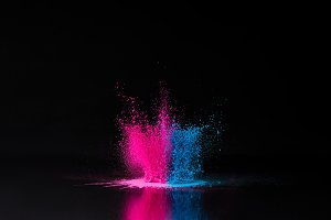 pink and blue holi powder explosion