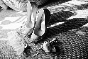 Close-up photo of bridal shoes, lace