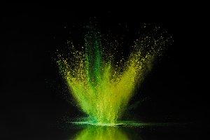 green and yellow holi powder explosi