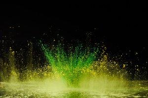 yellow and green holi powder explosi