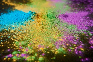 colorful holi powder on black, tradi