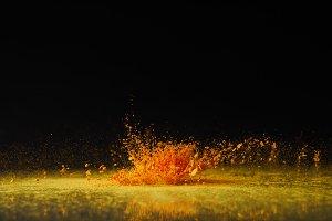 yellow holi powder explosion on blac