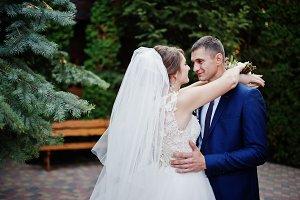 Young beautiful wedding couple walki