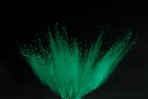 green holi powder explosion isolated