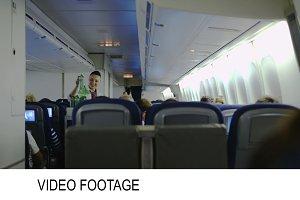 Stewardess giving drinks passengers