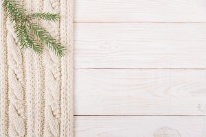Knitted and wooden background