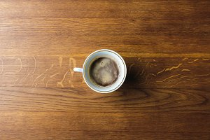 top view of cup of coffee on wooden