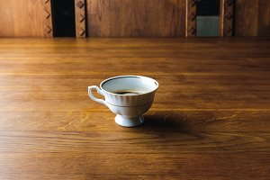 close-up view of cup of coffee on wo
