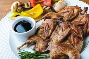 close-up view of roasted chickens wi