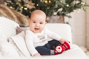 Funny baby girl.Christmas background