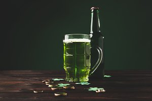 glass of green beer with shamrock an