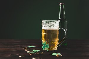 glass of beer with shamrock and gold