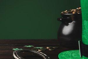 golden coins, horseshoe and green ha