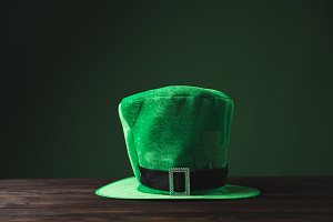 green hat on wooden table, st patric