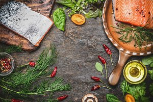 Raw salmon fillet with ingredients