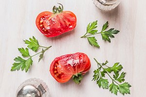 Half of tomatoes with herbs and salt