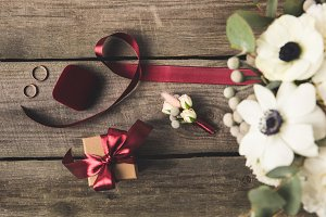 flat lay with ribbon, wedding rings,