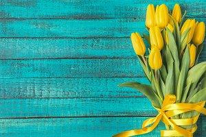 beautiful yellow tulips with ribbon