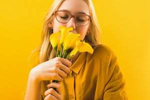 girl holding beautiful yellow calla