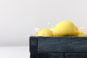 yellow painted easter eggs in wooden